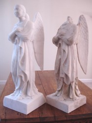 """Side by side, the original damage marble angel and the reproduction.  Damage and flaws can be """"edited"""" out and repairs """"edited"""" in."""